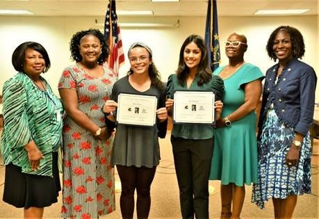 Addie Davis and Ria Agarwal are the 2021 recipients of the I Have a Dream Community Collaborative Scholarship. Pictured are (from left)DiLynn Phelps of Muncie Community Schoools, Tara Gudger of the Martin Luther King Jr.Dream Team, Davis, Agarwal, WaTasha Barnes Griffin of MCS and Rhonda Ward ofMCS.