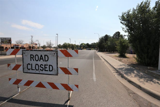 Madrid Avenue in Las Cruces is closed on Monday, June 21, 2021, as Las Cruces Police investigate a homicide in Apodaca Park.