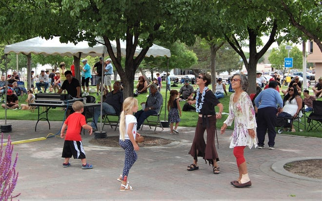 Members of the crowd dance to live music on May 29 during the Animas River Jam at the River Reach Terrace in Berg Park in Farmington.