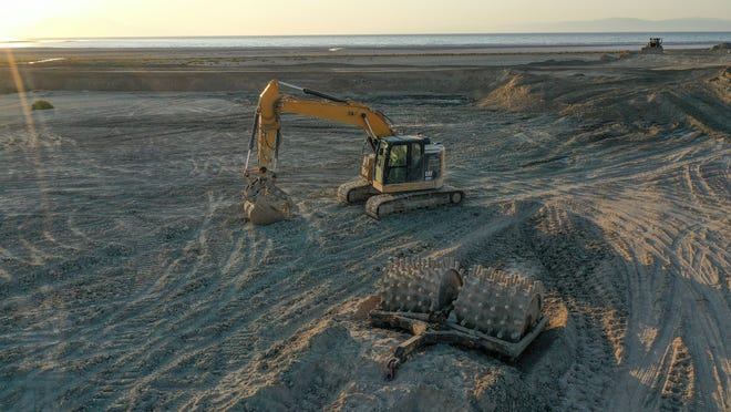 Heavy machinery used to create fields of trenches designed to trap the dust at the Salton Sea sits idle.