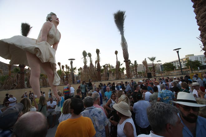 """People gather for the unveiling of the """"Forever Marilyn"""" statue in downtown Palm Springs, Calif., on June 20, 2021."""