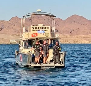 A Mohave County sheriff's rescue team searches for a missing teen who struggled while swimming around noon on June 20, 2021, in the area of the South Basin of Lake Havasu, near the Lake Havasu Water Safety Center.