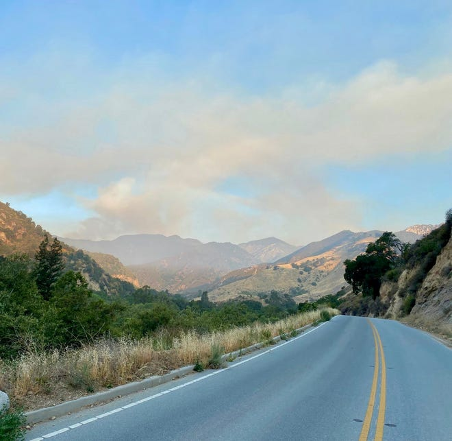 Plumes of smoke from the Willow Fire drift into the air above the mountains of Big Sur.