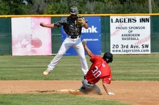 Michael Chevalier slides into 2nd base in Aberdeen on June 16, 2021.