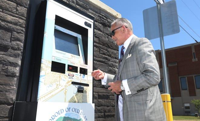 Zanesville Mayor Don Mason demonstrates the use of the city's bill paying kiosk near Secrest Auditorium in downtown Zanesville.