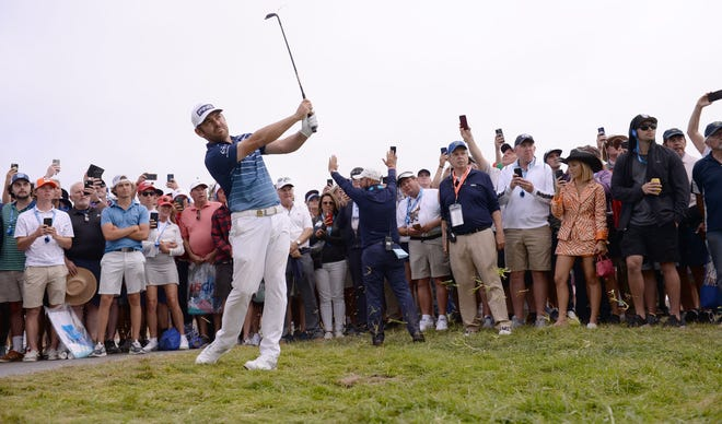 Final round: Louis Oosthuizen plays his shot on the 14th fairway rough during the final round of the U.S. Open.