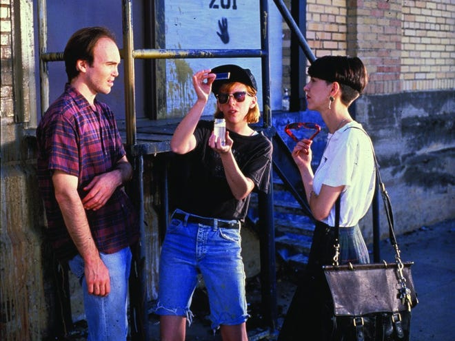 """Scott Marcus and Stella Weir of 1980s Austin band Glass Eye appeared in a memorable """"Slacker"""" scene with former Butthole Surfers drummer Teresa Taylor, who tries to sell them what she says is a Madonna pap smear."""