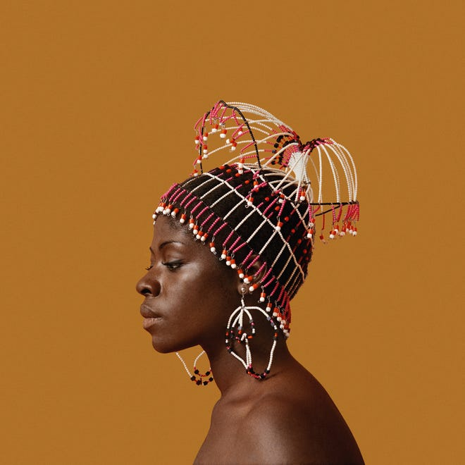 """Sikolo Brathwaite wearing a headpiece designed by Carolee Prince, posing for Kwame Brathwaite, the New York-based photographer who catapulted the """"Black is Beautiful"""" movement into the mainstream."""