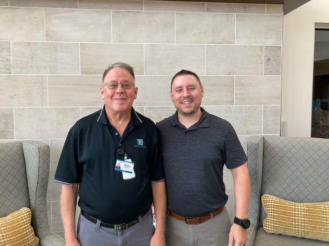 Murry Moore, left, and his son Brian Moore work together at Bridgemoor Transitional Care in Round Rock, where Murry is a van driver and Brian is a technology support supervisor for the facility.