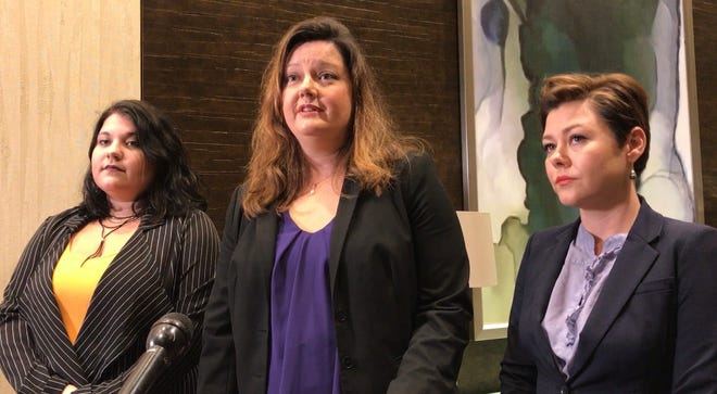 Jennifer Ecklund, center, is one of the attorneys for the women who sued Travis County and Austin officials, accusing them of failing to properly investigate and prosecute sexual assault cases.