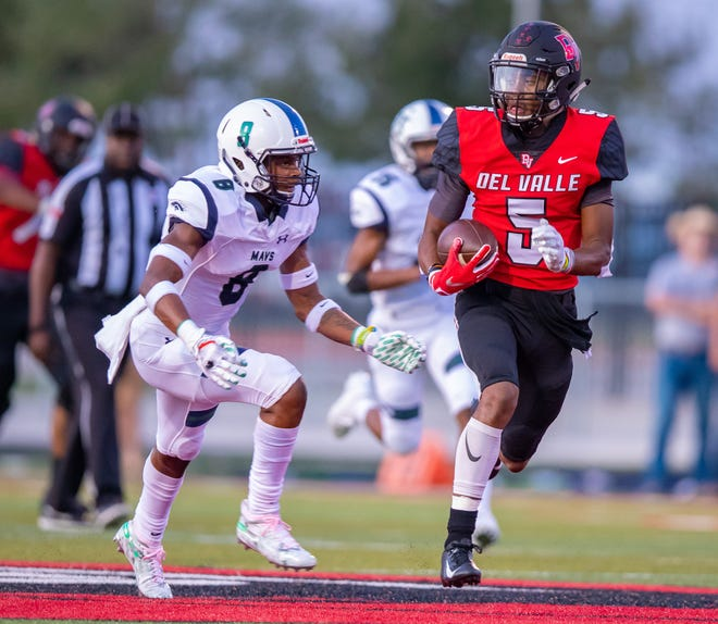 Caleb Burton, right, runs after the catch for Del Valle against McNeil in a 2019 game. Burton, who now plays for Lake Travis, had 82 catches for 1,515 yards and 18 touchdowns in his first two high school seasons before missing the 2020 campaign with an injury.