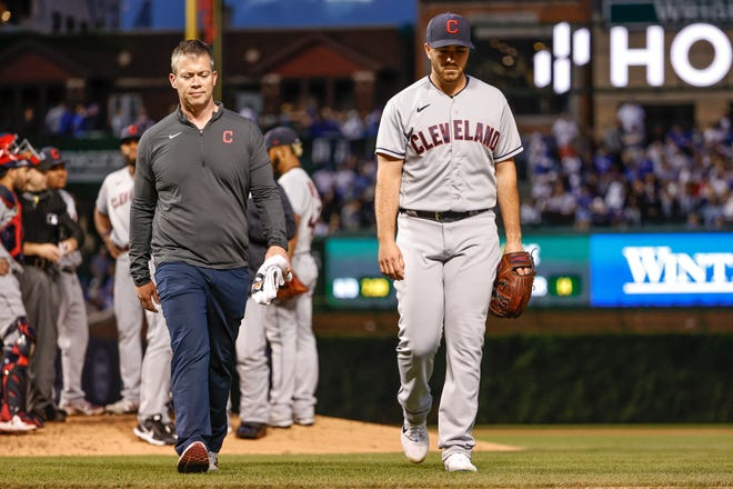 Jun 21, 2021; Chicago, Illinois, USA; Cleveland starting pitcher Aaron Civale (43) leaves a baseball game against the Chicago Cubs due to injury during the fifth inning at Wrigley Field.