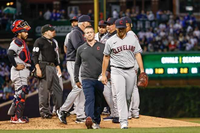 Cleveland starting pitcher Aaron Civale (43) leaves the game against the Chicago Cubs due to an injury during the fifth inning at Wrigley Field, June 21, 2021.