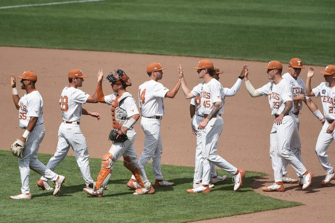 Texas players celebrate Tuesday's 8-4 elimination game victory over Tennessee at the College World Series. The second-seeded Longhorns next play Thursday night against the loser of the Virginia-Mississippi State game.
