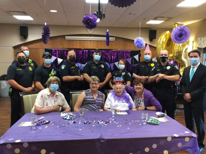 Ashland Mayor Matt Miller and members of the city's fire and police departments came to Belmont Tower on June 10 to escort June Lemmel from the elevator to the dining room for a big birthday bash during lunch in honor of her 105th birthday, which was on Saturday, June 12.