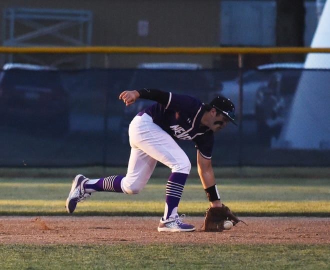 Nevada's Marshal Sheldahl reaches his glove down to field a grounder at second base during the Cubs' non-conference rivalry game with Ballard June 15 at Nite Hawk Field in Slater. The Cubs fell by a 12-2 score in five innings.