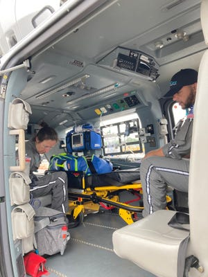 LeAnne Carson, left, a flight nurse and paramedic, and Corey Monroe, a flight paramedic, aboard the AU AirCare air ambulance helicopter on Tuesday.