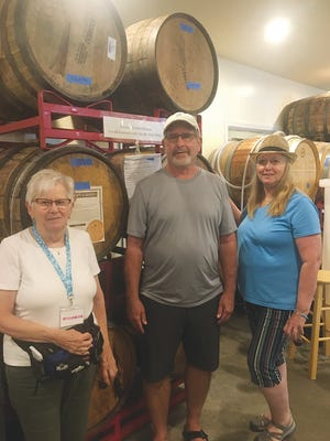 Touring the Pecan Creek Winery in Muskogee are Wheeler Dealers members Clarice Olsen, left,  of Bartlesville, Mark Metevia of Norman, and Ellen Cobb of Ponca City.