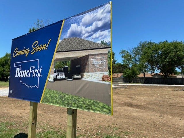 BancFirst is constructing a drive-thru with two interactive teller machines on the lot at 3600 SE Price Road. The ITMs will have video monitors connecting tellers from a remote location to the customer, functioning as a bank drive-thru. After business hours, the machines will function as ATMs.