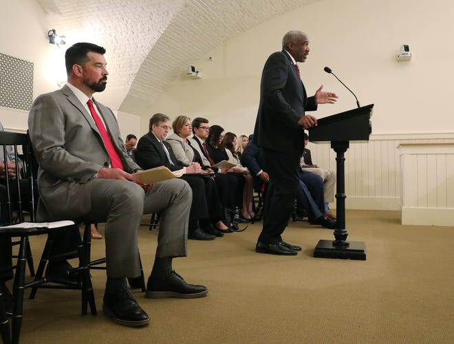 Ohio State head football coach Ryan Day, left, listens as Ohio State athletic director Gene Smith, right, testifies on name, image and likeness bill, at the Ohio Statehouse on Tuesday, June 22, 2021.