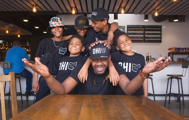 """Crafted Culture founder Anthony """"Sizzle"""" Perry (foreground) at the Gahanna taproom with his kids, from left: Robyn, Thomas, Isaac, Joe and Thomas' twin brother Daniel"""