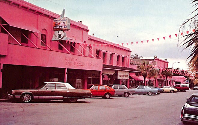 """The storefronts along the eastside of Donnelly Street between Fourth and Fifth Avenues painted pink for the movie """"Honky Tonk Freeway."""""""