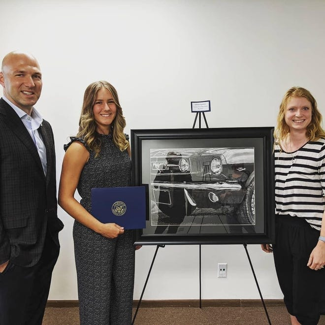 U.S. Rep. Anthony Gonzalez (left to right), Northwestern graduate Allison Spencer and Leah Smith, art teacher at Northwestern High School, pose for a photo after Spencer received the People's Choice Award for her artwork at this year's Congressional Art Competition.