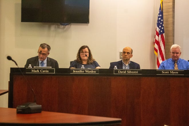 Wooster city council members discuss a resolution.