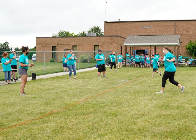 HOPE Community Center in Adrian this week had a scaled-down version of the Special Olympics for its members. Events included the long jump, softball throwing and running, pictured Monday.