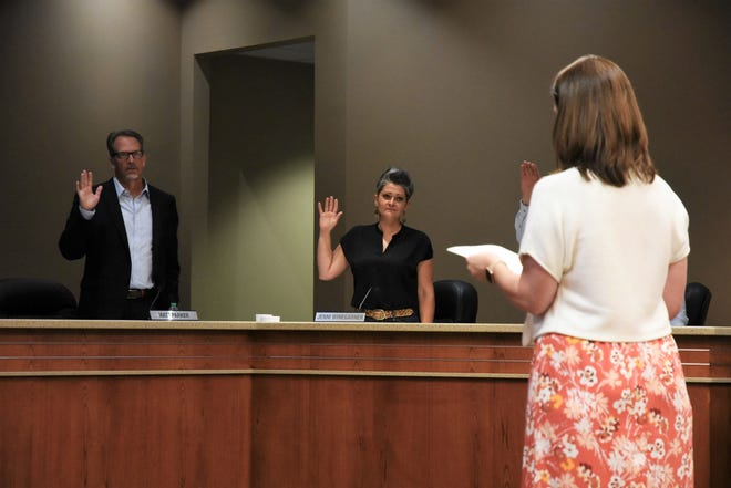 Matt Parker and Jenni Winegarner take the oath of office during Canyon ISD Board of Trustee meeting on June 21, 2021 at the Canyon ISD Administration Building.