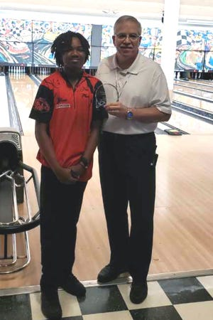 Tyshaun Baxter (left) receives his award for winning the PBA Junior regional tournament in Mooresville. [Contributed photo]