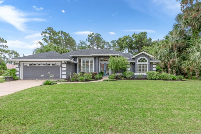 This unique oasis on over half an acre in the Palm Coast community of Palm Harbor has recently undergone a complete interior renovation, including stunning tile flooring and stone countertops throughout.