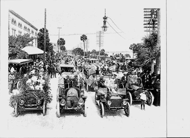 Decorated cars line up a Fourth of July parade on Beach Street in early 1900s.