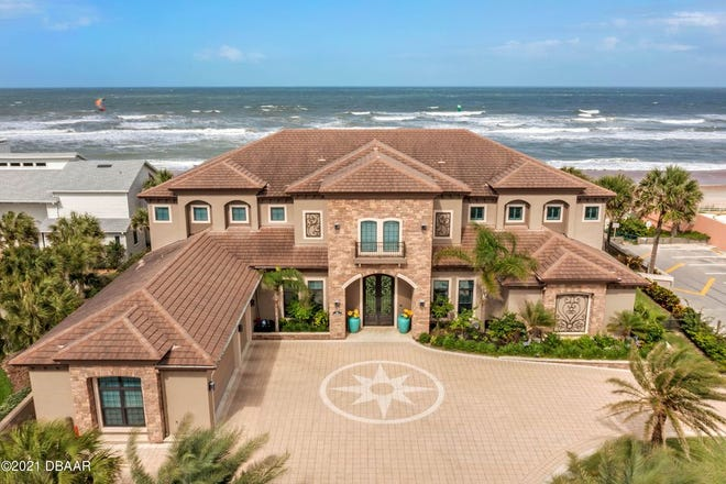 From Ocean Shore Boulevard, majestic double gates open to find this magnificent oceanfront estate in Ormond Beach.