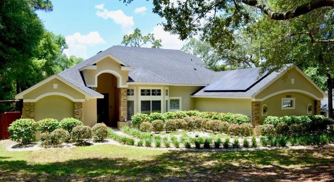 This fully renovated pool home in DeLand's Westminster Woods is situated on over a half-an-acre property, with a fully fenced backyard.