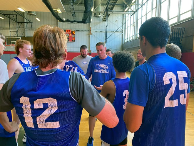 Grain Valley basketball coach Andy Herbert discusses strategy with his team during a scrimmage Monday at Van Horn High School. The Eagles beat Fort Osage and lost to Hogan Prep and the host Falcons in their first time on the court playing against another school since March.