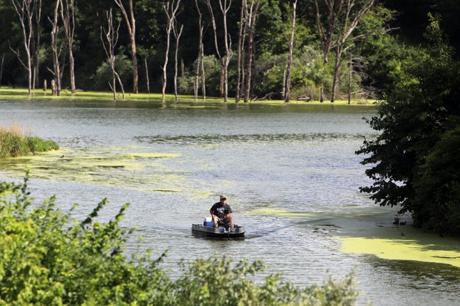 George Knight heads back to shore June 22 after fishing for crappies at Big Hollow Lake at Big Hollow Recreation Area near Sperry. A Big Hollow Water Quality Symposium was given Wednesday evening to citizens about what's being done to improve water quality at Big Hollow Lake.