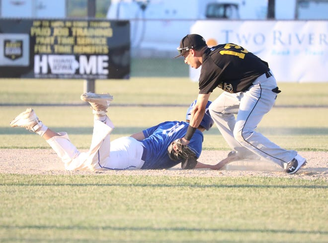 New London's Hecniel Rodriguezgoes for a tag on Danville's Ethan Unzicker at second base in their game at New London Monday night.