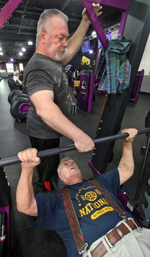 Jim Putnam spots his father, 86-year-old Bill Putnam, as the two work out at Planet Fitness of Shelby on East Dixon Boulevard Tuesday afternoon, June 22, 2021.