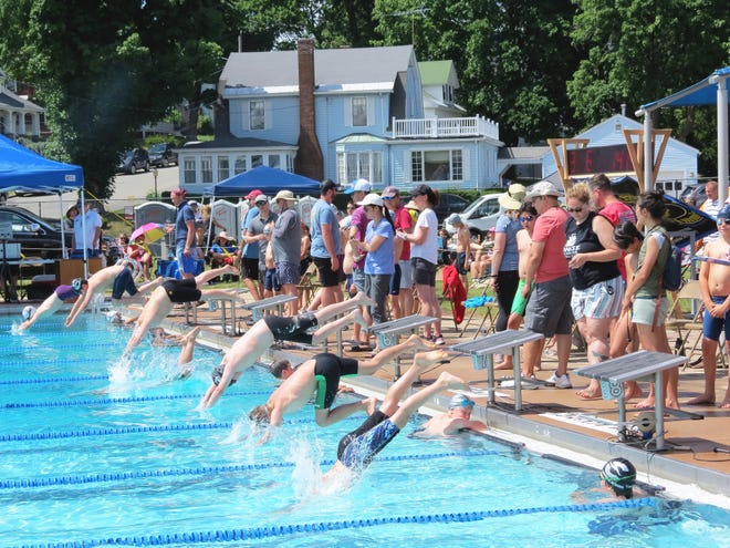A large crowd of people from throughout New England descended upon Gardner for a recent swim meet hosted by the Greenwood Swim Club.