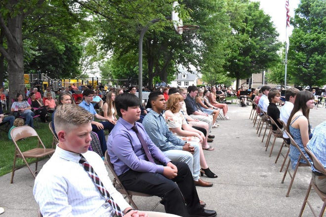 After the processional, some of the Orion Middle School eighth graders are seated at the band shell in Central Park, which hosted the eighth grade promotion ceremony on Monday, May 24.