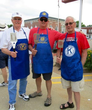 Getting ready to march in the Music Fest Doo-Dah Parade are Geneseo Rotary members, with their spatulas, from left, Dale Tanis, Wayne Stone and Paul Mosher.