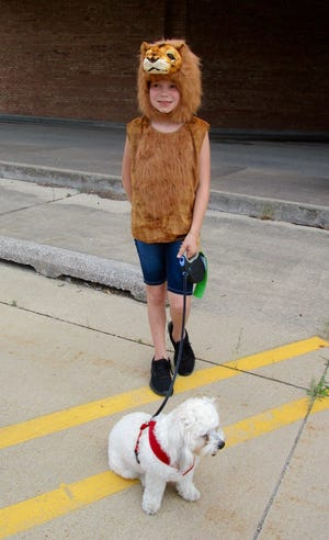 """Gracie Wilson, as a tiger, and """"Jax"""" were among the participants in the Doo-Dah Parade."""