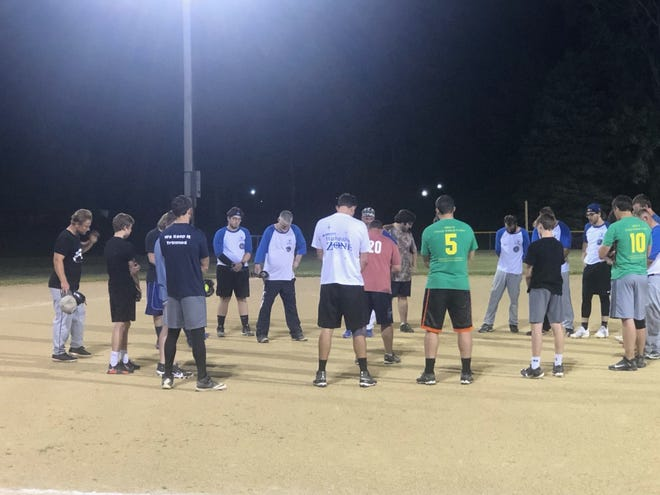 After Monday night's doubleheader on Richmond Hill in Geneseo, softball players from First United Methodist and St. Malachy's Catholic joined together for prayer. St. Malachy's won both games.