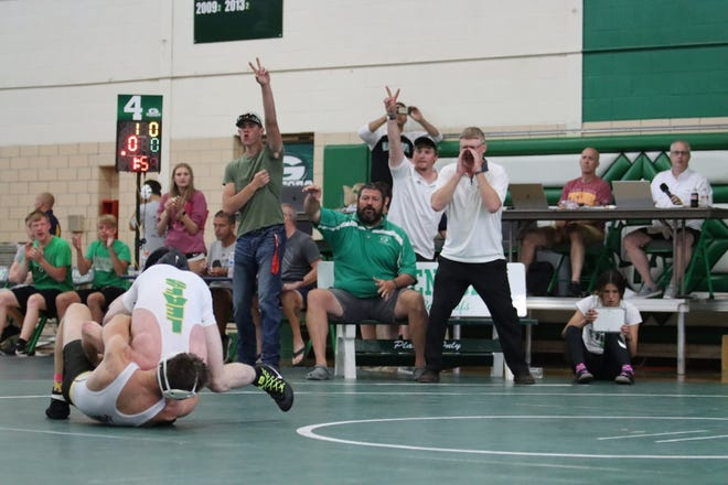 Teammates and coaches cheer as Logan Tuggle executes a takedown to win the Championship match at the 132-pound weight class at the 2021 2A wrestling Sectional hosted by Geneseo. Tuggle, along with eight of his teammates, will wrestle at the IWCOA State Tournament on Friday in Springfield.