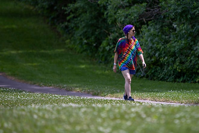 Anna Brown of Galesburg walks on a path at Lake Storey Park near US150 on Tuesday afternoon.