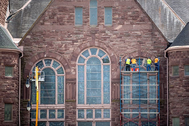 Workers with Jacksonville Stained Glass, Inc. repair windows at Central Congregational Church, 60 Public Square, on Monday, June 21, 2021.