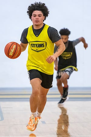Galesburg High School senior Dre Egipciaco dribbles the ball up the floor during a drill at basketball camp on Tuesday, June 22, 2021 at the GHS fieldhouse.