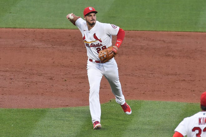 St. Louis Cardinals third baseman Nolan Arenado throws out Miami Marlins' Jesus Sanchez during the third inning of a game Tuesday, June 15, 2021, in St. Louis.