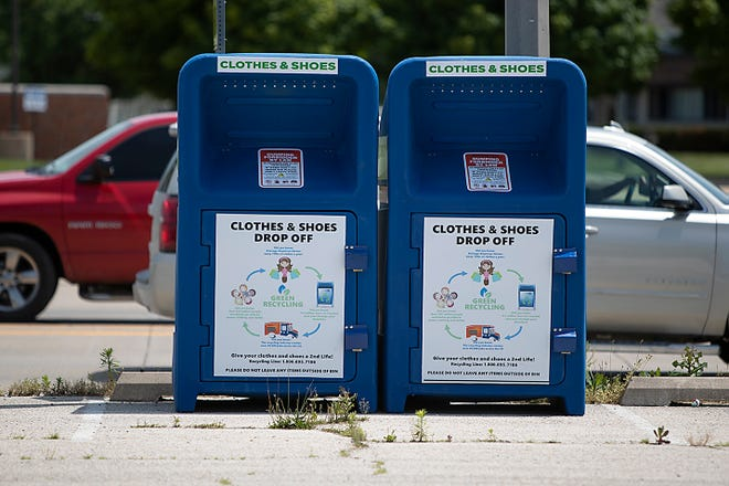 Traffic on Henderson Street passes a pair of clothing and shoes collection boxes in front of the former Northgate Family Recreation Center, 1576 N. Henderson St., on Tuesday.